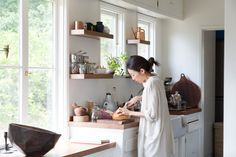 Faced with a 1948 fixer-upper, fashion designers Momo Suzuki and Alexander Yamaguchi of Black Crane approached their rooms the way they create their minimalist clothes: with an eye to simple elegance and a nod to their Japanese roots. And by bargain shopping too—did we mention that they made French doors from windows bought at Home Depot?