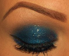 "Sparkle On: Holiday Party Eye Shadow Picks - Be the star in the midnight sky using midnight blue and silvery glitter liner. Try Too Faced Smokey Eye Palette (Midnight Blue) and Too Faced Starry Eyed Liner in Silver Lining to get a shimmering ""star"" quality look to your lids. Then pour on the liner and mascara for a smouldering stare."