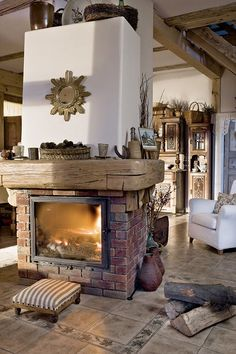 like - the muted colors of the fireplace brick and mantle