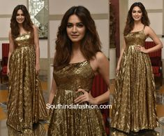 Kriti Kharbanda was snapped at her friends wedding in a shimmering golden gown. Nude make-up look and loose hair-do balanced out the bling look. Disco Fashion, Pop Fashion, Kriti Kharbanda, Gold Gown, Indian Gowns Dresses, Bollywood Actress Hot Photos, Celebrity Outfits, India Fashion, Indian Designer Wear