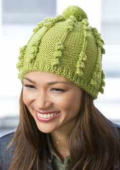 Free knitting pattern for Her Bobble Hat one skein hat - Cathy Payson designed this cute hat with optional pompom for Red Heart that takes one skein of yarn.