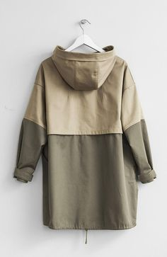 TWO TONE PARKA JACKET : Fabric: CottonColor: Beige and KhakiCare: Machine Wash Cold/ Tumble Dry Low Two-tone hooded oversized parka with two front pockets. Made in USA. Iranian Women Fashion, Hooded Vest, Mod Fashion, Sporty Fashion, Pants For Women, Clothes For Women, Front Bottoms, Mode Hijab, Hoodie Outfit