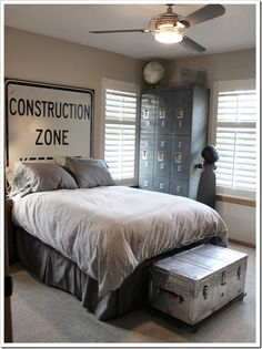 Neat Idea for an industrial bedroom:  Giant Sign as a headboard, lockers and a trunk on casters for cool looking storage