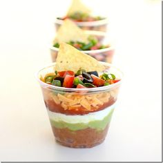 Seven Layer Dip in a Cup.  Takes care of that community dip dish & fun for a party.  from Iowa Girl Eats...