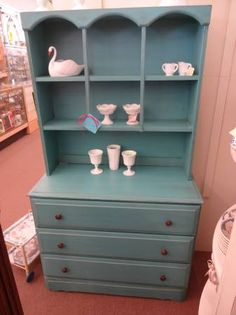 $159 - 2 piece hutch with 3 drawers in base and open shelves on top - painted turquoise and distressed and finished with a tinted wax.  ***** In Booth EF at Main Street Antique Mall 7260 E Main St (east of Power RD on MAIN STREET) Mesa Az 85207 **** Open 7 days a week 10:00AM-5:30PM **** Call for more information 480 924 1122 **** We Accept cash, debit, VISA, MasterCard or Discover.