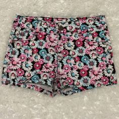 Kids Shorts Super Cute Shorts! Black w/ pink, white,teal Flower print. Slight wear from sitting but not noticeable cause of print still great condition. Size 8 Only lined dried smoke free home. More pics @ request :) Epic Threads Bottoms Shorts