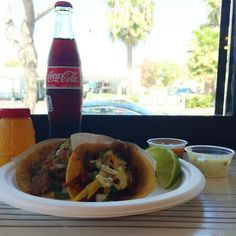 """Dos con todo with a """"Coca""""! The best way to celebrate #nationaltacoday is with good company! The classic combo never disappoints   #letstaco #thetacostand #hechoamano"""