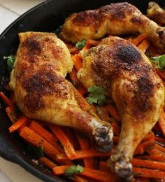 Spiced Chicken over Carrots Recipe - The chicken is seasoned with a spice rub that helps the skin get crispy and baked over carrots for a one dish meal.