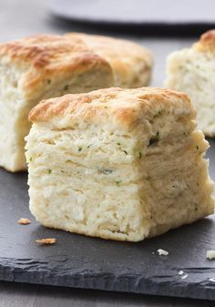 Layered Herb Biscuits: 2 1/2 C unbleached all-purpose flour + more for work surface, 1 Tbs plus 1/2 tsp baking powder, 1 Tbs sugar, 2 tsp kosher salt, 8 Tbs (1 stick) cold unsalted butter cut into 1/4-inch cubes, 1 C whole milk cold, 2 Tbs finely chopped fresh chives, 1 tsp fresh thyme leaves. Bake at 450° for 20-25 minutes. Makes 12.