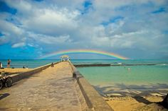 a rainbow right at the end of the pier in Waikiki!