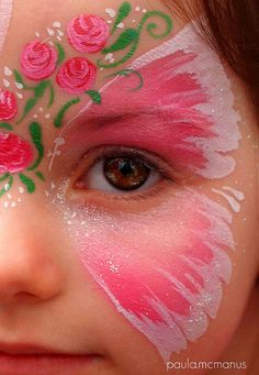Face painting done by Clare Smith.- butterfly with roses face painting, very beautiful