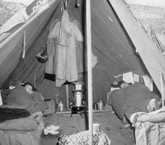 2 Army nurses sleeping in their tent, a small wall ~