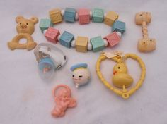 Vintage infant / baby crib toys and rattles.