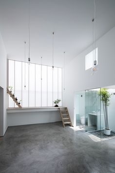 yoshiaki yamashita has completed a house on a corner plot in japan, which relies on a shoji screen to illuminate its interior.