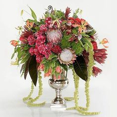 Arrangement of roses, protea, carnations, and other blooms in our Nickel Urn by Roberto Gonzalez. #RobertGonzalezDesigner. Nickel Urn, JamaliGarden.com