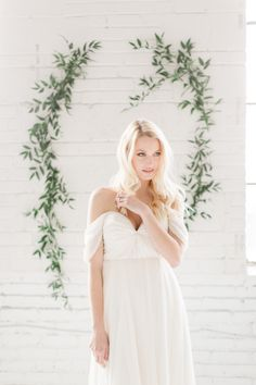 Draped off-the-shoulder wedding dress: http://www.stylemepretty.com/canada-weddings/quebec/montreal/2016/07/27/urban-organic-romantic-styled-shoot/ | Photography: Lisa Renault Photographie - http://www.lisarenault.com/