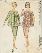 An original ca. 1960 McCall's pattern 5373.  Maternity Two-Piece Dress. Yoked-front overblouse and slim, three-gore kangaroo skirt. Short or three-quarter length sleeves in one with blouse back and front yoke. Short sleeved lace blouse is completely lined, has inverted pleat at either side front. Low pleat at back of skirt which expands by means of tape tie-strings and strap.