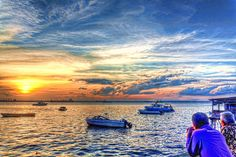Two elderly men are enjoying a rather fine sunset on Melawai Beach, Balikpapan.