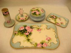 This gorgeous hand painted dresser set is the perfect blend and combination of antique Limoges and porcelains from Bavaria.