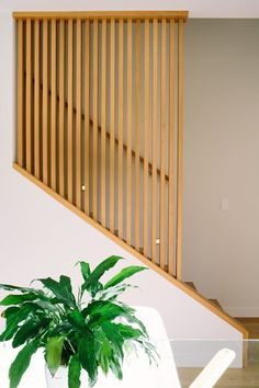 Beautiful wooden panel on this staircase from Design Crush.    |  IRPINO Construction: Residential & Commercial Construction in Chicago. #Construction #Chicago http://www.irpinoconstruction.com/