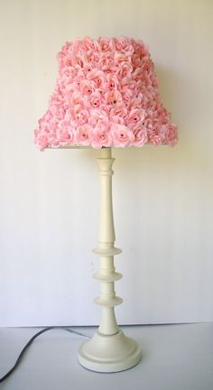 Really cute DIY idea for any plain old lamp. Any color that goes with your room will be awesome! It doesn't have to be flowers just make it YOU. Becareful of a really powerful lightbulb.