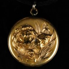 Victorian lioness and cub locket.