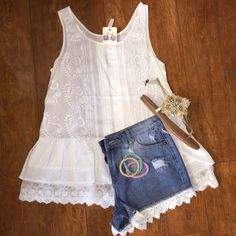 Love white lace! Perfect with a pair of boots for a country concert this summer!