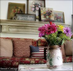 Floral sofa with vintage floral pictures above.