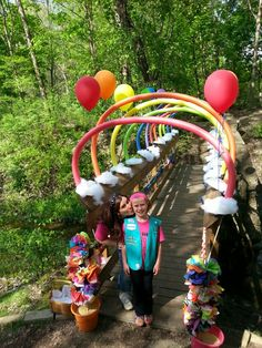 Girl Scout Bridging Rainbow Noodle Bridge with Paper plate clouds filled with batting.