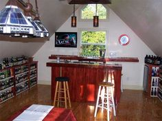 This homeowner transformed unused space above the garage into the perfect getaway for watching baseball games, playing poker, and having friends over for drinks with the addition of a bar, wine/beer fridge, AC, and TV. | thisoldhouse.com