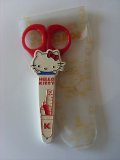 Hello Kitty scissors...OMG! These are vintage awesomeness! My mom gave me a pair in the same case, except the scissor handles were blue...probably back in '85! :)