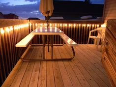 I love the idea of deck lighting using outdoor twinkle lights! She said she waited until the after Christmas sales to make it cheap. So whimsical and romantic!