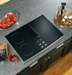 GE Profile Series 30 inch Stainless Steel Electric Cooktop - PP989SNSS by GE. $1392.30. Bridge element. Ribbon heating elements. Downdraft exhaust. Ceramic-glass cooktop. Beautify your kitchen island with this GE PP989SNSS downdraft electric cooktop. Its stainless steel design impresses while its performance gives you the quality cooking you've been looking for. Four radiant elements of this electric cooktop provide ample heating space for frying chicken and boiling po...