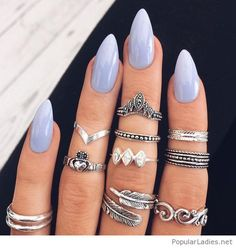 long-light-blue-nails-with-silver-rings