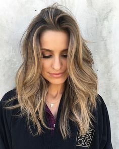 Balayage, brunette to blonde. wavy curls to loosen it up.