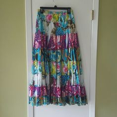 CATO SKIRT Very full long skirt, very colorful. The length of the liner is below the knee. It is a medium but runs bigger and has a dart on both sides that was put to make it a little smaller but can be taken back out Cato Skirts A-Line or Full