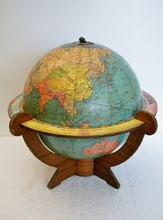 Vintage Globe 1942 Airways Globe - WWII Globe  This style-where the globe is sitting in a stand is at the top of my wish list.