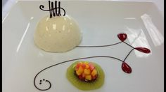 Vanilla Bean Bavarian with piped chocolate, raspberry sauce and brunoised mangos and strawberries on a kiwi