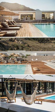 Mur en pierre apparente et terrasse en bois moderne – Casa Cook en Grèce