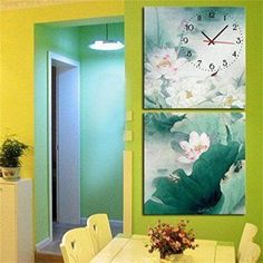 Create a relaxing refuge in your home with lotus flower wall art. You can use lotus flower wall decor in any room of your home but especially bedrooms, living rooms and bathrooms.  Although I love it in my office.  You can find cute lotus flower clocks, lotus flower wall tapestries, lotus flower wall decals, lotus flower wall murals that loook cute. Royal-Modern Style canvas painting Ink painting lotus flowers Wall Clock in Canvas 2pcs