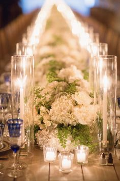 Kinda love the way these candles line the floral tables cape!