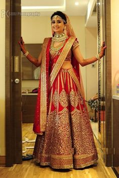 1-sabyasachi-bridal-lehenga-in-red-and-gold-shades