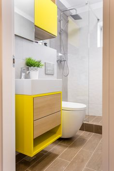 Small bathroom design, renovated by our team in Bucharest. Happy colors furniture and 3D tiles used.