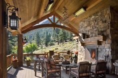 Beautiful covered porch.  Rustic Elegance Design Ideas, Pictures, Remodel and Decor
