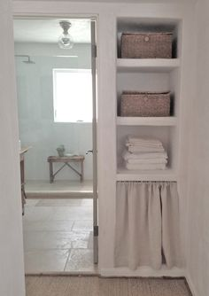 Plaster shelves & invisibly installed glass! Love the clean aesthetic of this space!