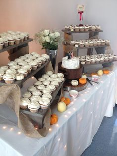 I would have the cake sit higher and have signs for the cupcakes. Instead of pumpkins,I would do more flowers or ivy. The lights under table...MORE OF THEM! haha!