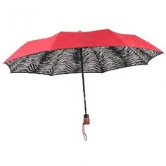 Red Double Canopy Umbrella with Zebra Print interior.  @ www.let-it-rain.com