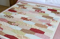 Tumbler quilt from fig tree fabrics.