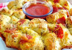Pull-Apart Pizza Bread--A fun appetizer.  Even has a hole in the middle to place the marinara sauce for serving.