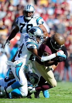 LANDOVER, MD - NOVEMBER 04: Robert Griffin III #10 of the Washington Redskins is tackled by Josh Norman #24 of the Carolina Panthers during a game at FedExField on November 4, 2012 in Landover, Maryland. (Photo by Patrick McDermott/Getty Images)